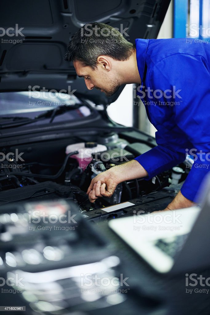 Performing a thorough vehicle service royalty-free stock photo