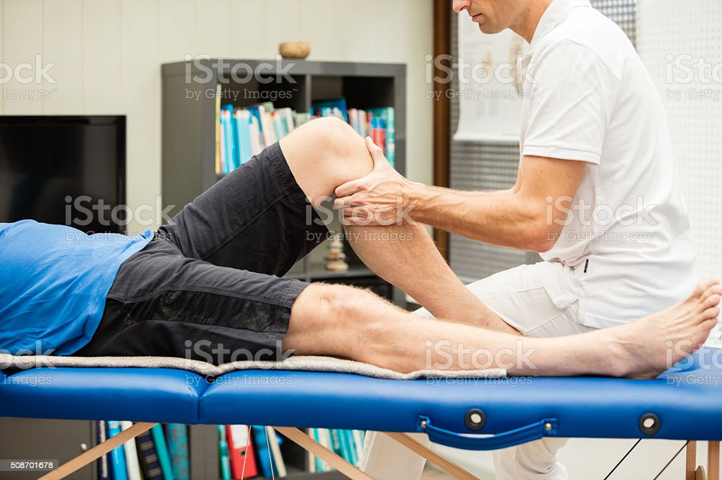 Performing the anterior drawer test in left knee stock photo