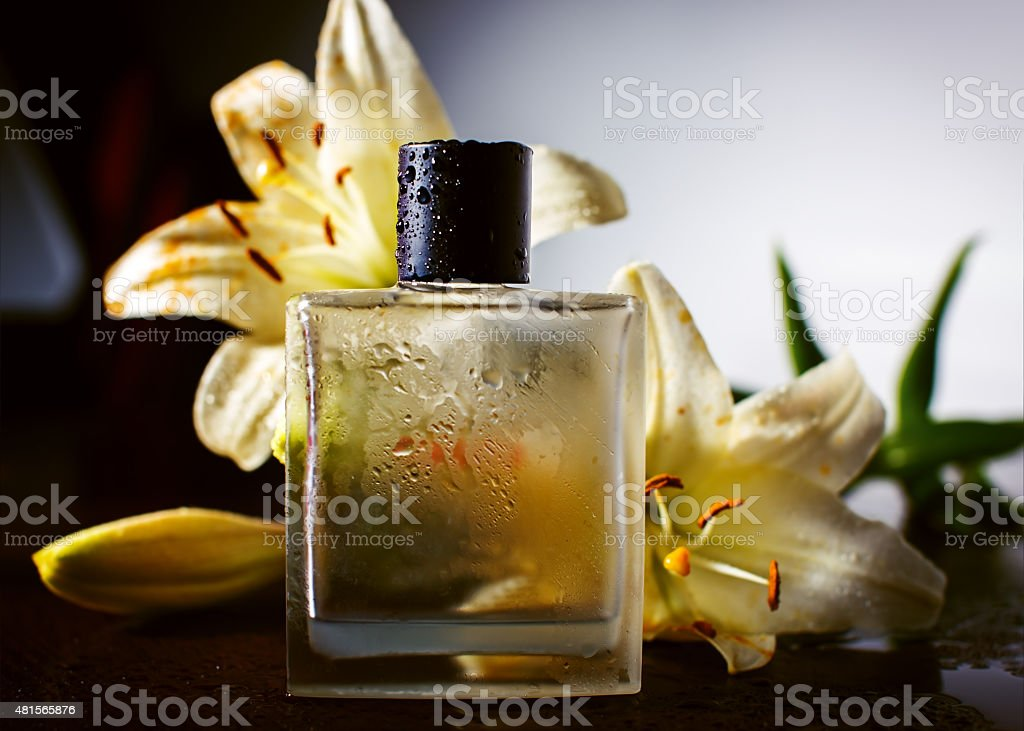 Perfume and flowers stock photo