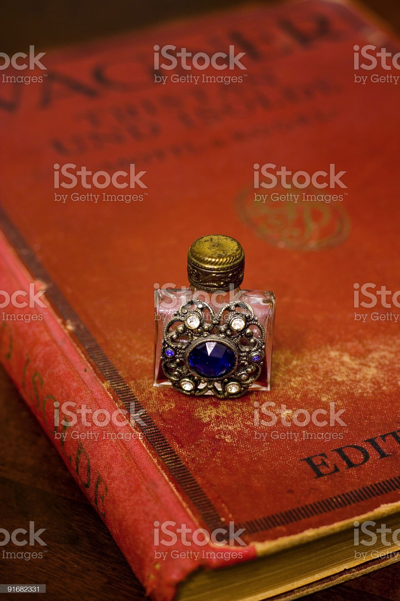 Perfume and old score-book royalty-free stock photo