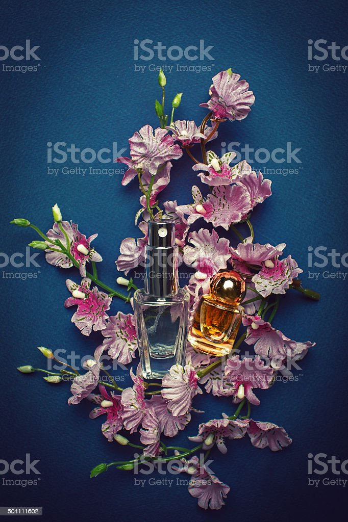 perfume and pink flowers stock photo