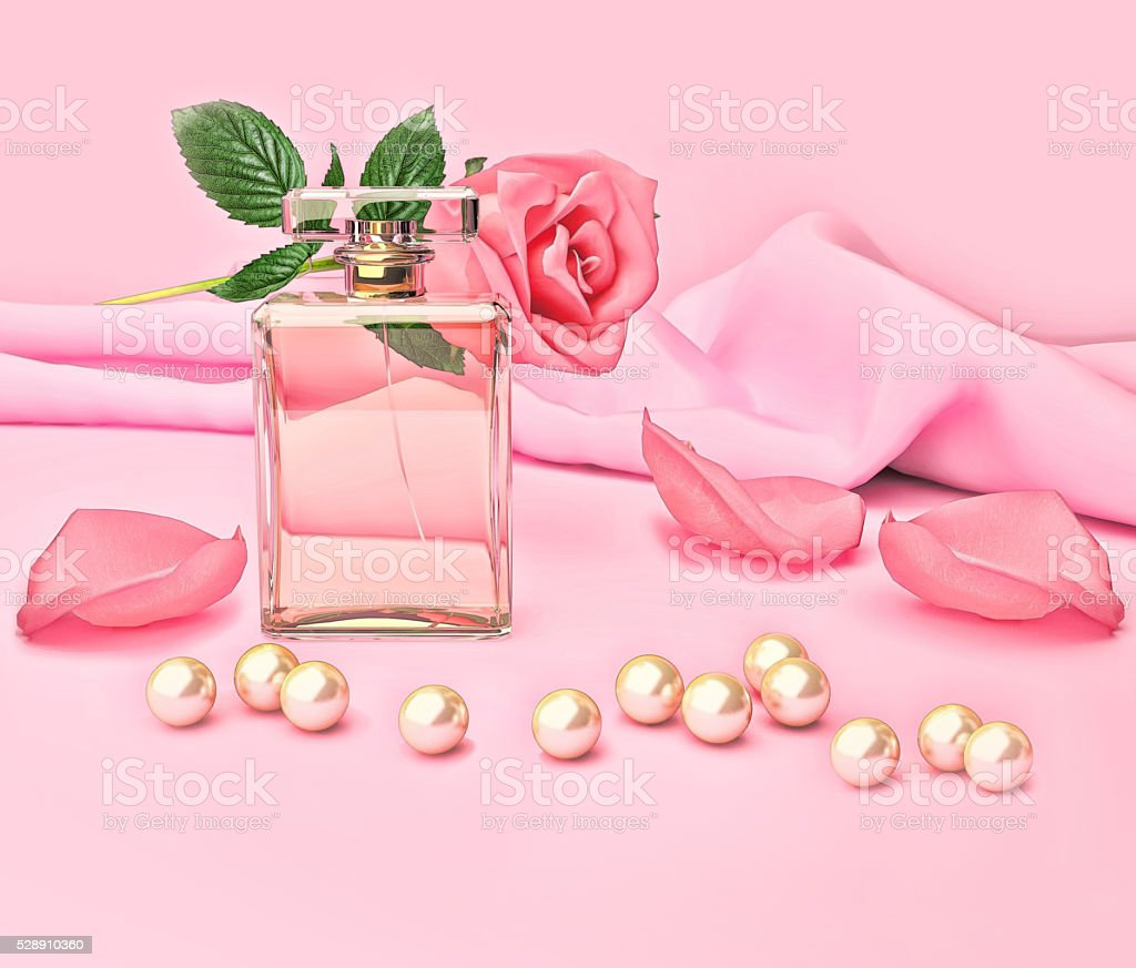 Perfume bottle and flower rose, petals and pearls on pink stock photo