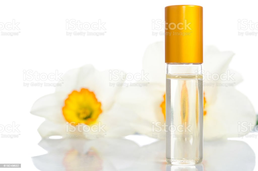perfume bottle with flowers isolated on white stock photo