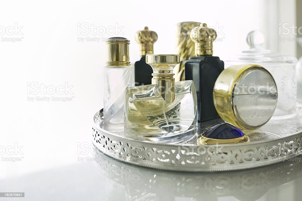 Perfume bottles on a silver tray royalty-free stock photo