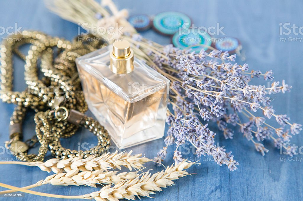 perfume with a bouquet of lavender and jewelry stock photo