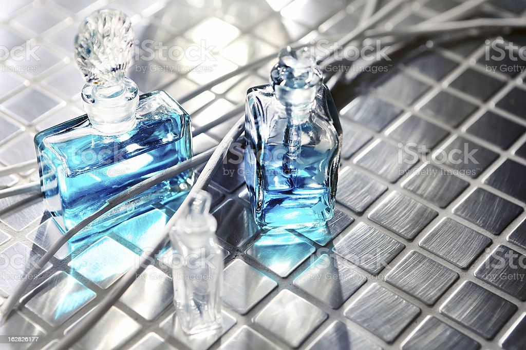Perfume with beautiful flowers on the table stock photo