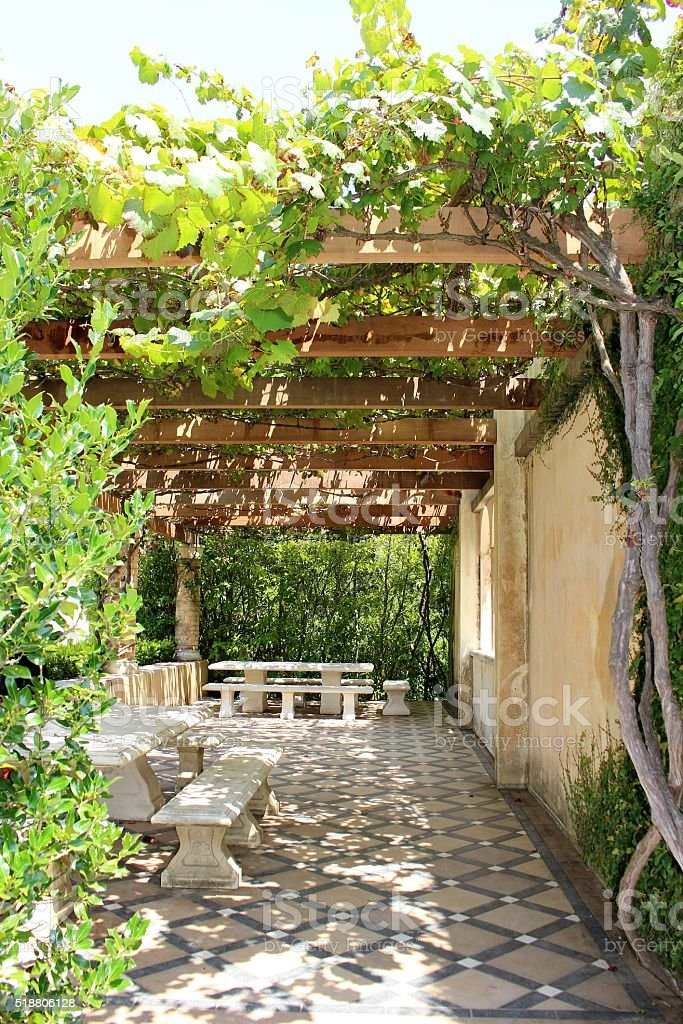 Pergola covered tiled picnic area stock photo