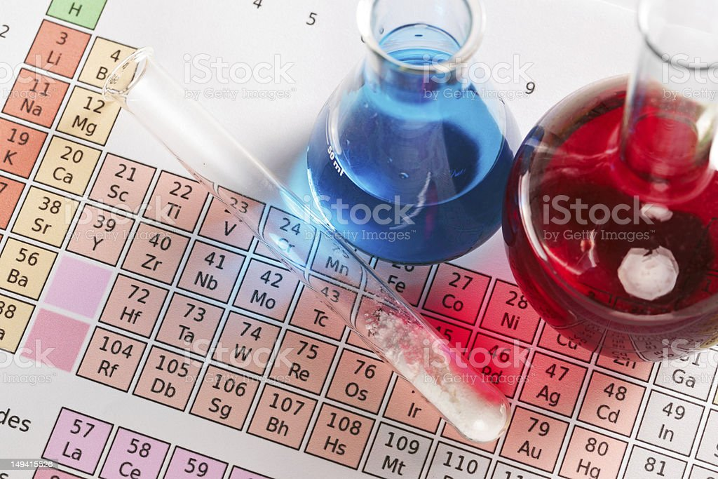 Periodic table and chemicals stock photo