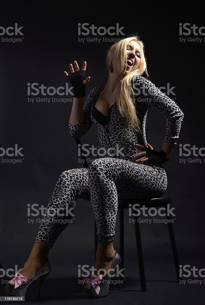 Perky woman in the catsuit dappled royalty-free stock photo