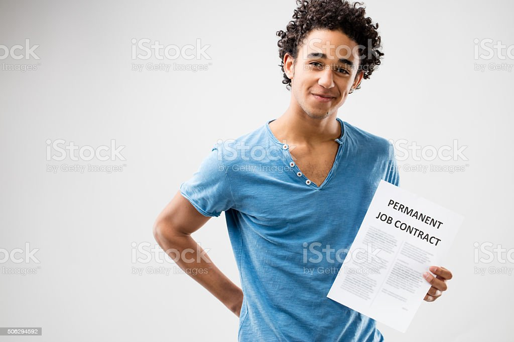 permanent job contract shown by a young man stock photo