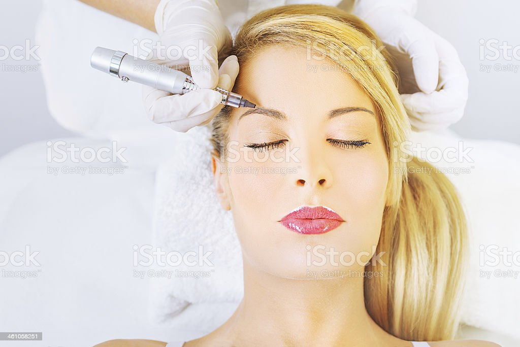 Permanent make up on eyebrows stock photo