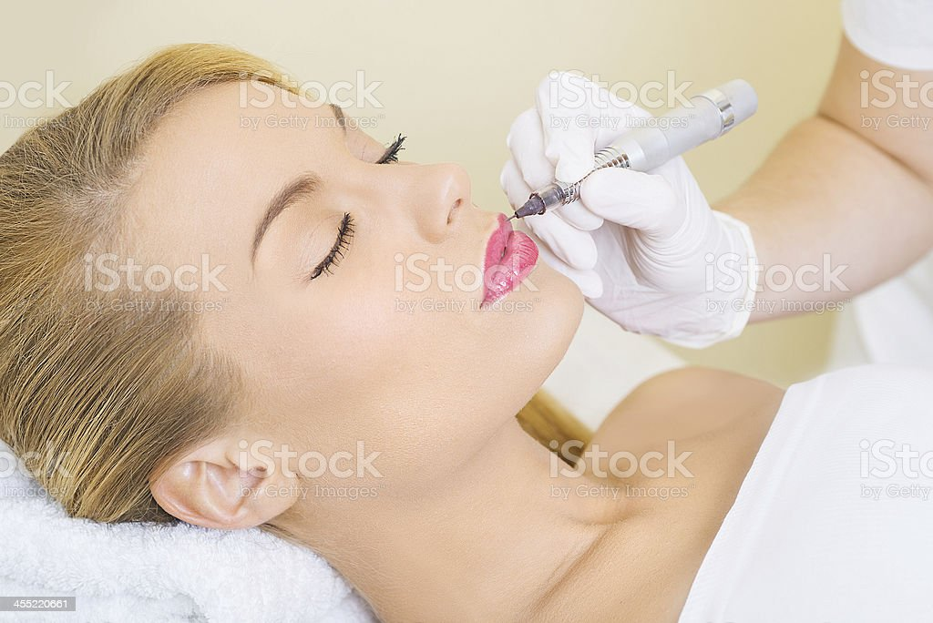 Permanent make up on lips stock photo