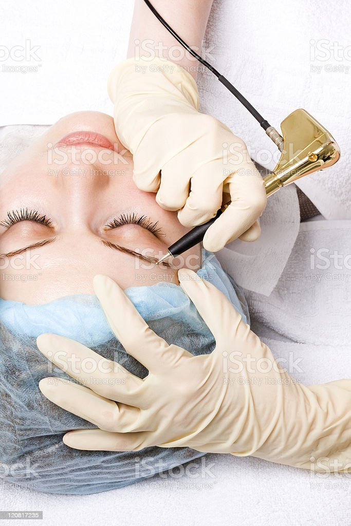 Permanent makeup for eyebrows Safety articles are used  royalty-free stock photo