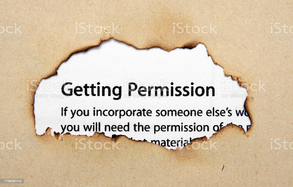 Permission text on paper hole royalty-free stock photo