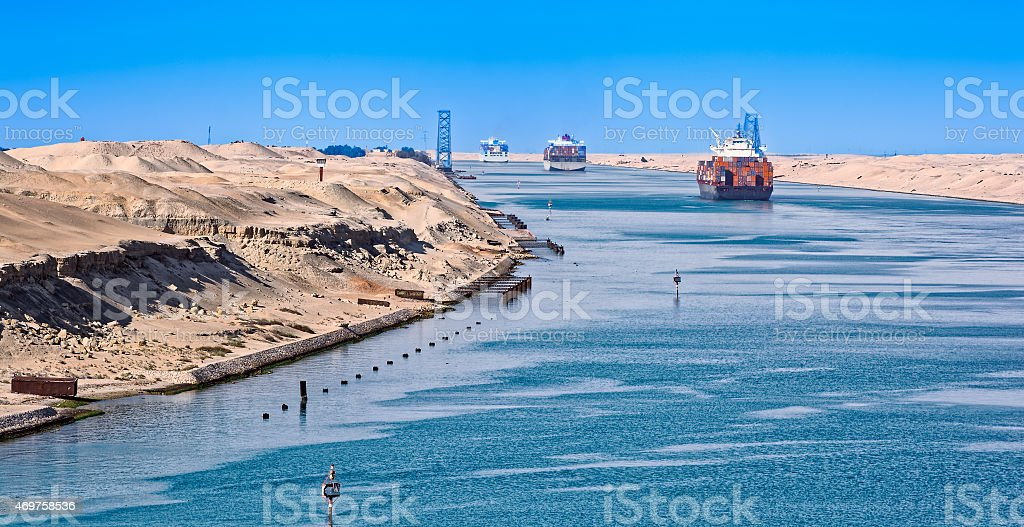 Perpective of the Suez Canal and ships passing through stock photo