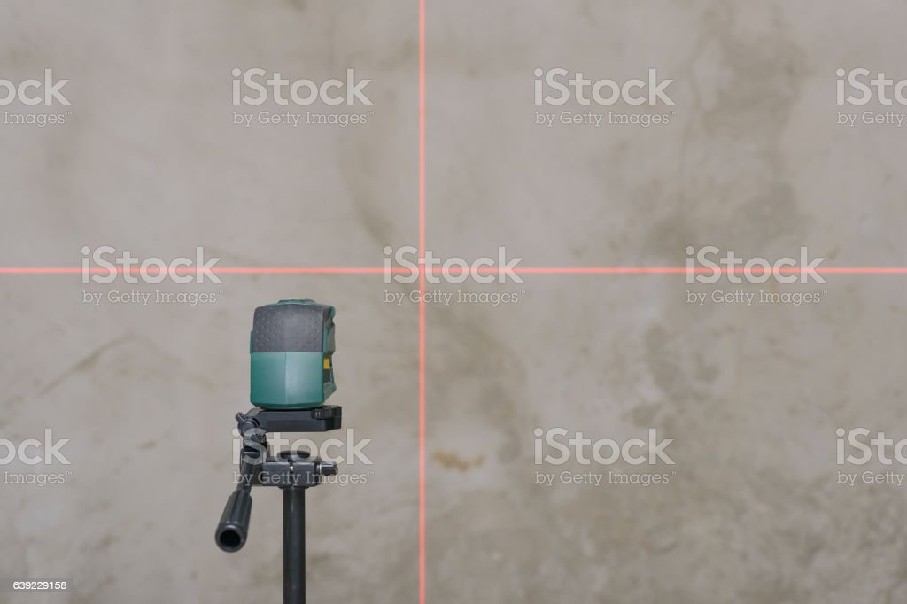 perpendicular rays of the laser level on the wall stock photo