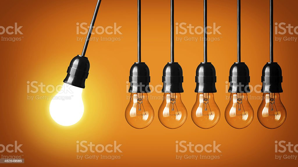 Perpetual motion with light bulbs stock photo