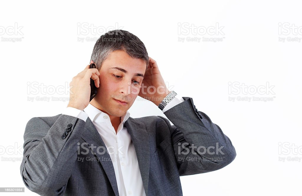 Perplexed businessman on the cellphone royalty-free stock photo