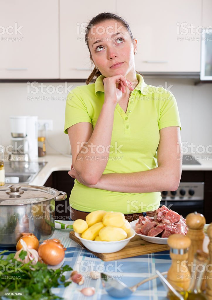 Perplexed woman with meat stock photo