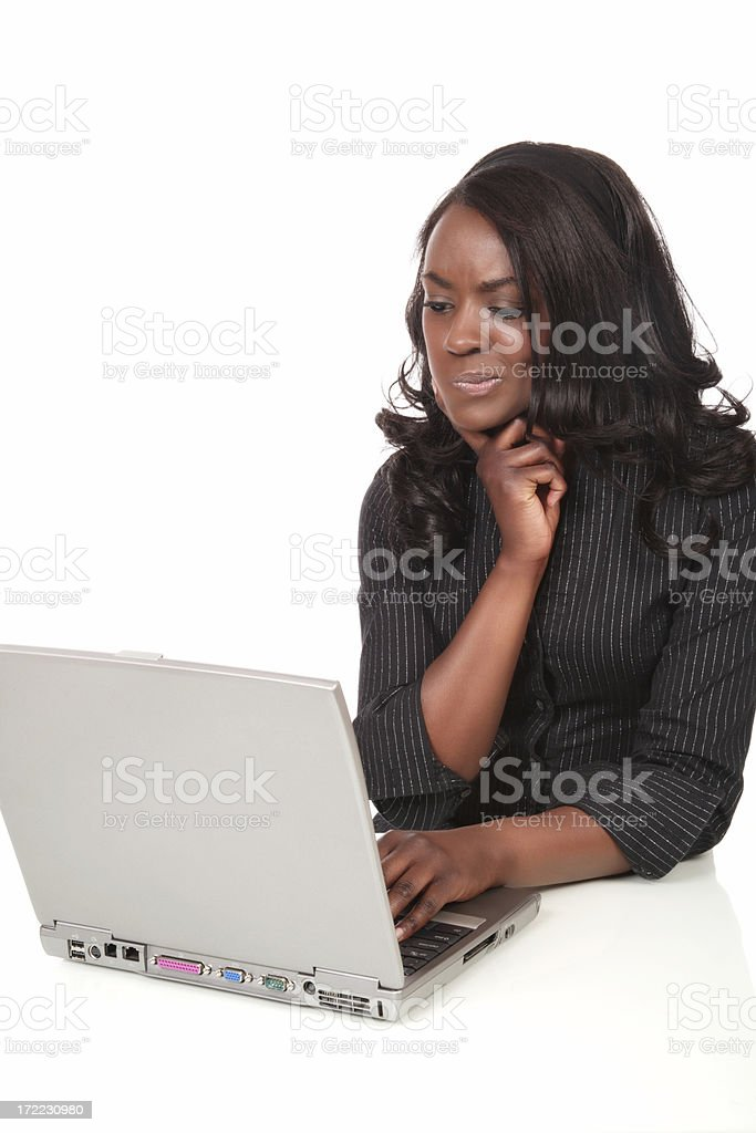 Perplexed Young Woman with Laptop stock photo
