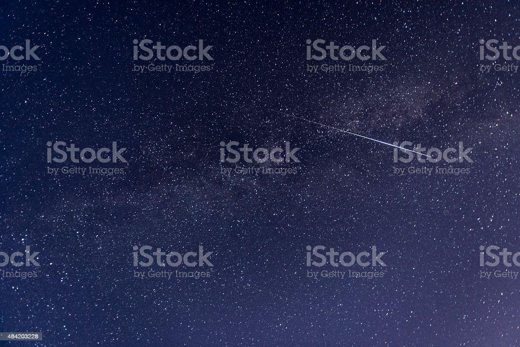 Perseid meteor crossing the sky stock photo