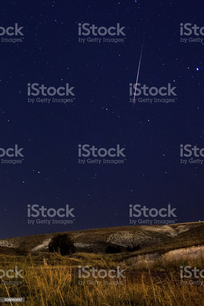 Perseid meteor over the steppe stock photo