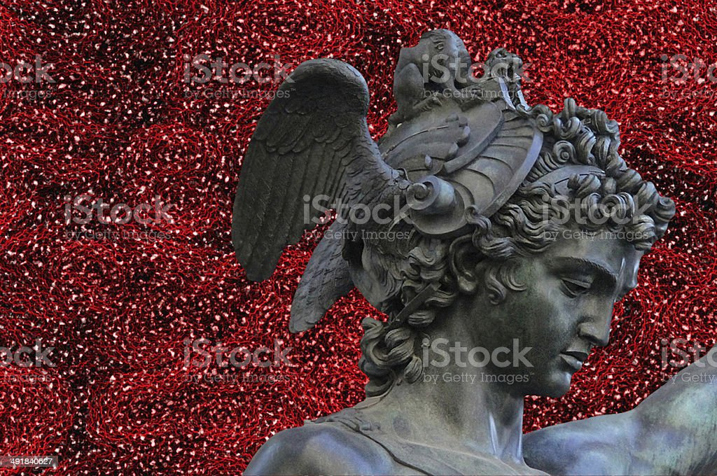 Perseus holding head of Medusa on red abstract background stock photo