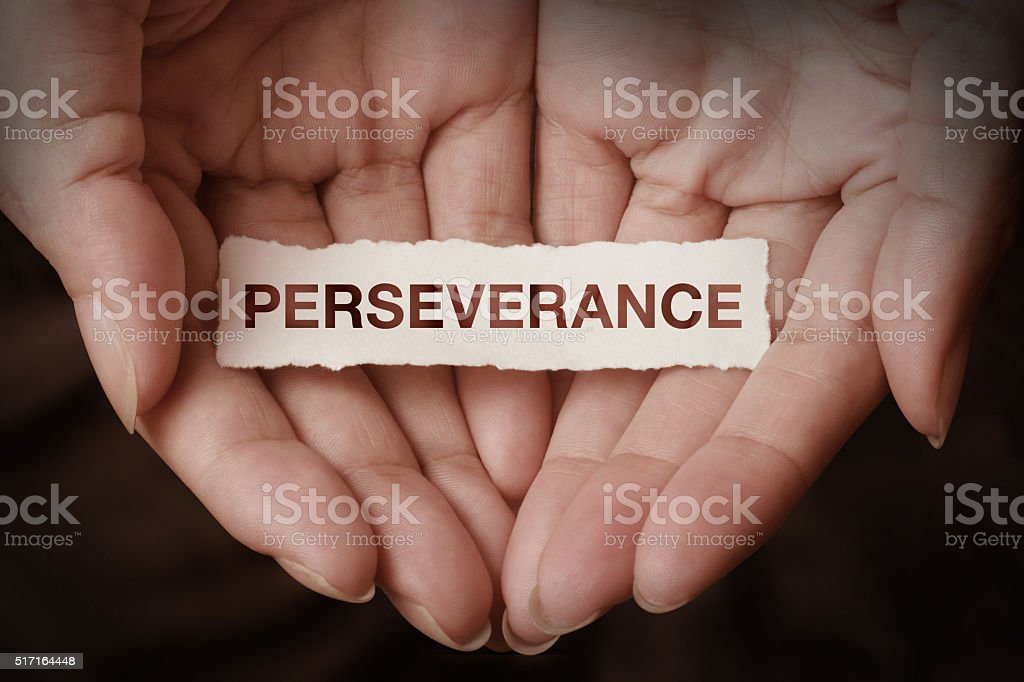 Perseverance text on hand stock photo