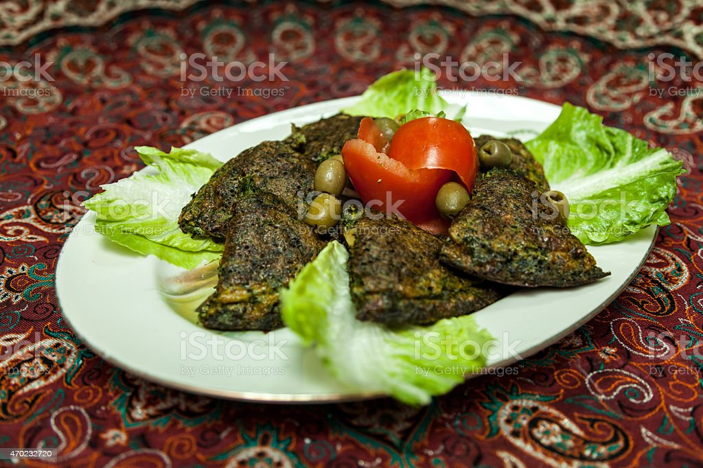 Persian herbed quiche (omelette) stock photo