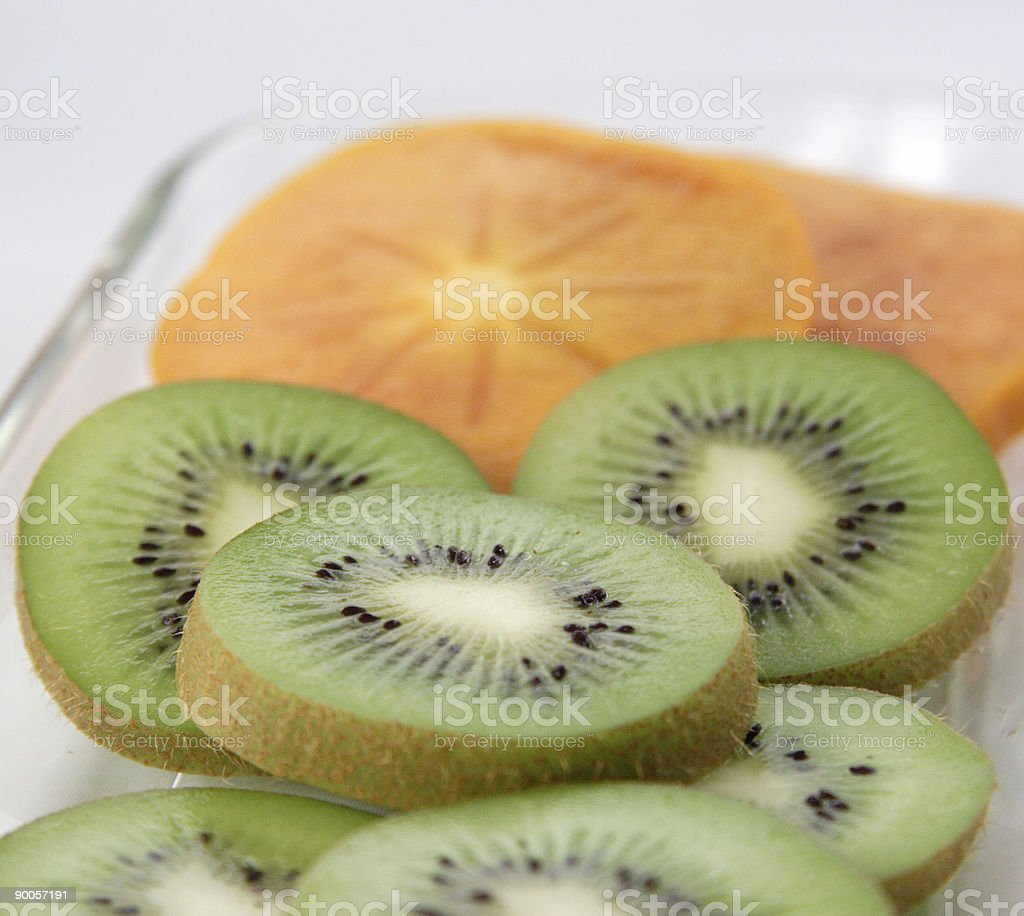 persimmon and kiwi royalty-free stock photo