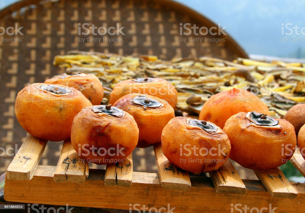Persimmon drying on the street of Chinese village stock photo