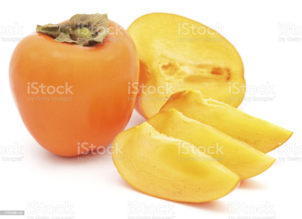 Persimmon with slices on white background royalty-free stock photo