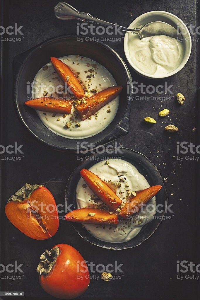 Persimmons greek yogurt stock photo