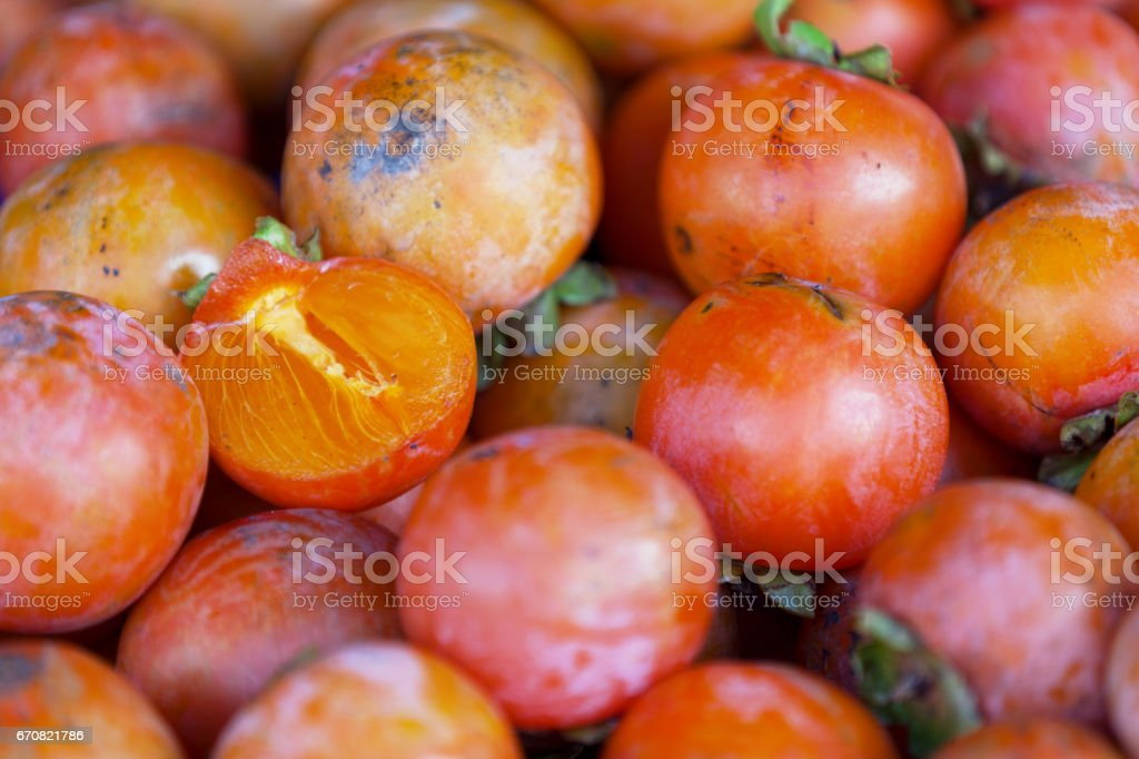 Persimmons on a market stall stock photo