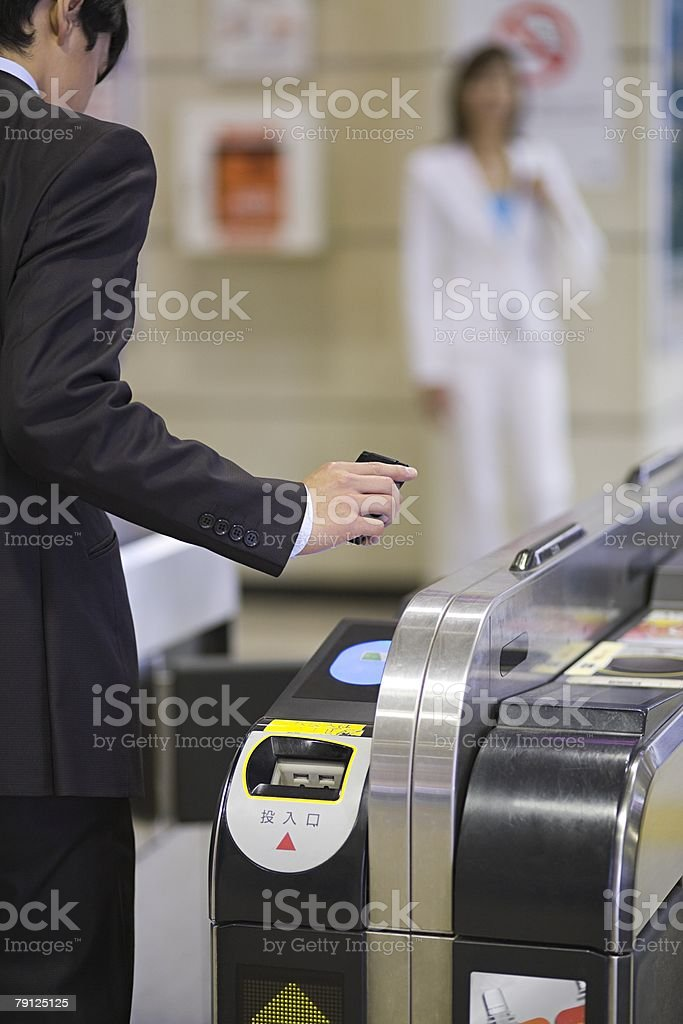 Person at ticket barrier stock photo