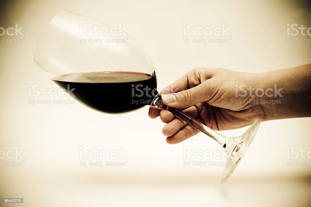 Person being careless with a glass of red wine royalty-free stock photo
