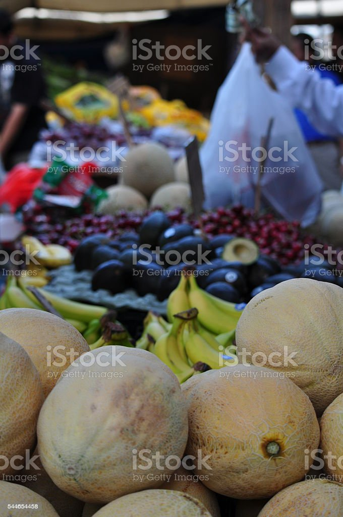 Person Buying Fruit at Outdoor Food Market stock photo