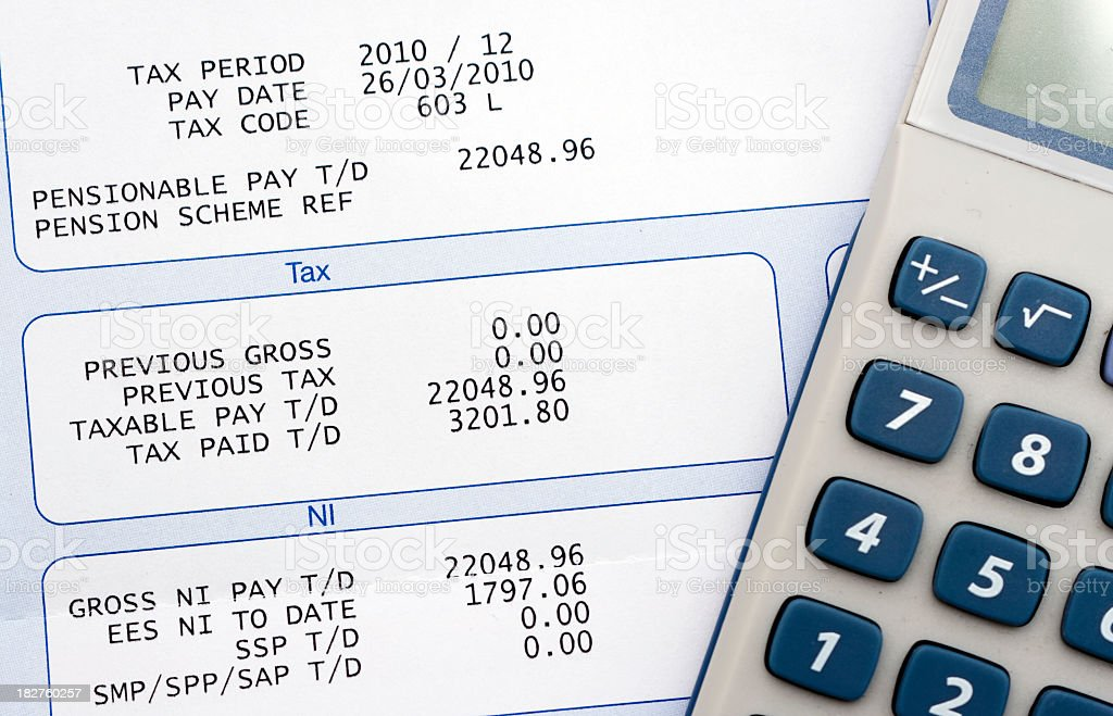 Person calculating money earned stock photo