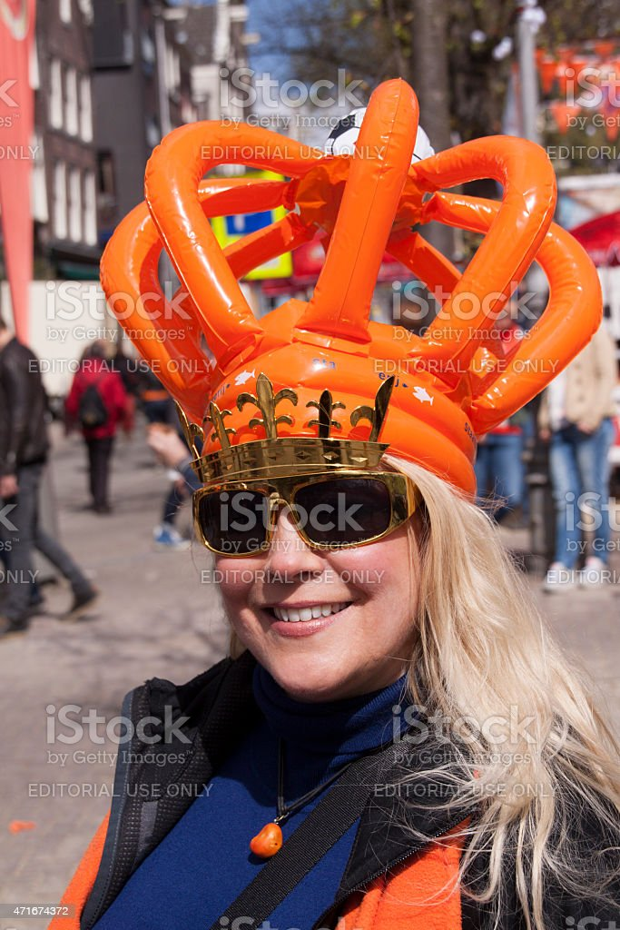 person celebrating kingsday in outfit in Amsterdam stock photo