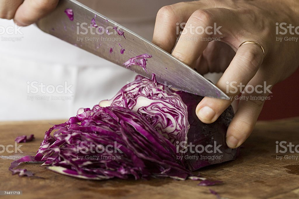 Person chopping red cabbage stock photo