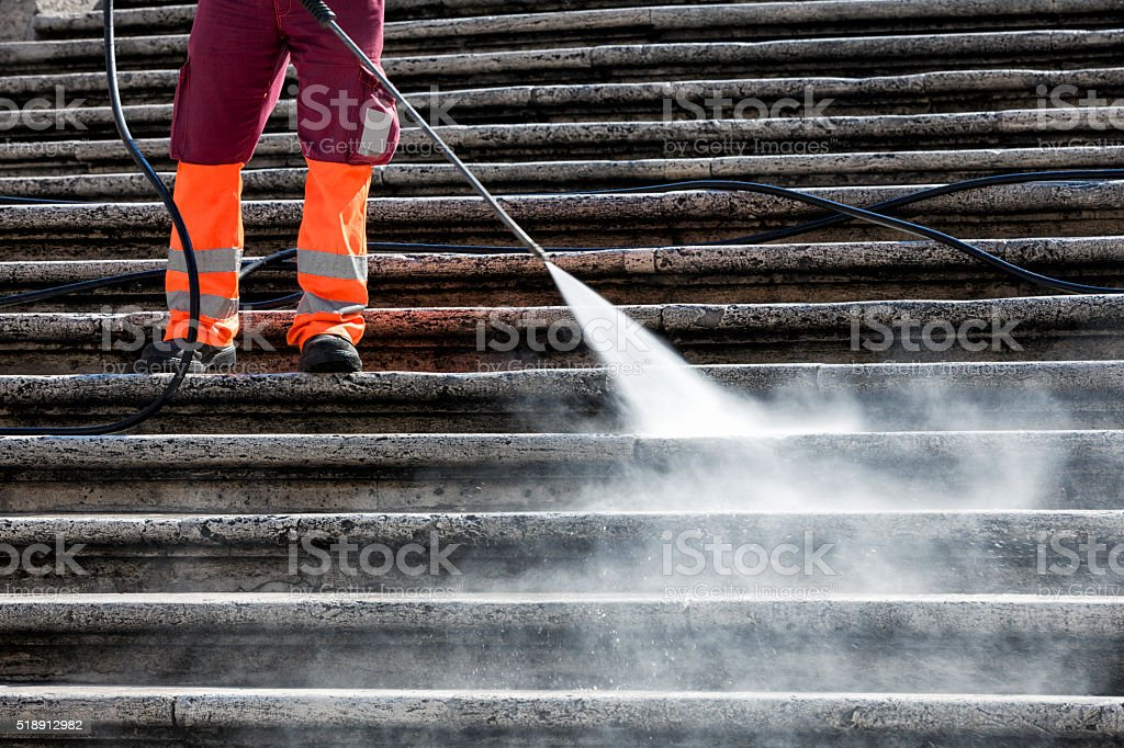 Person cleaning the Spanish Steps in Rome, Italy stock photo