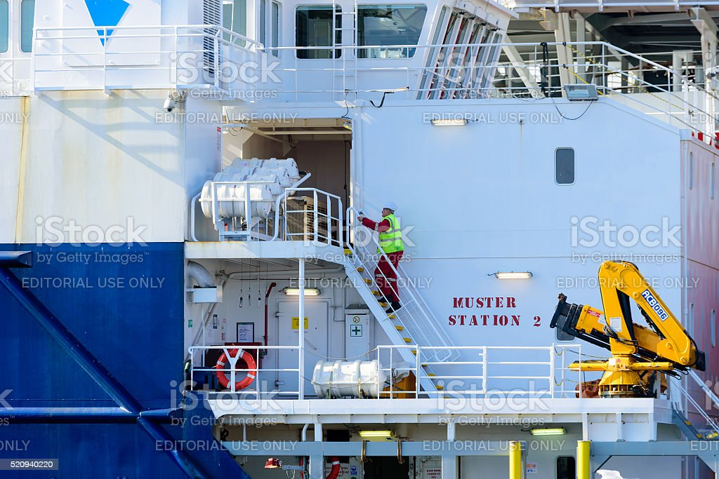 Person climbing stairs at ship stock photo