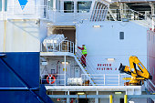 Person climbing stairs at ship
