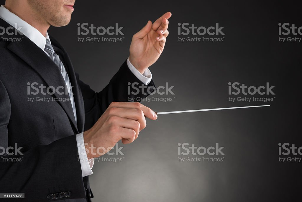 Person Directing With A Conductor's Baton stock photo