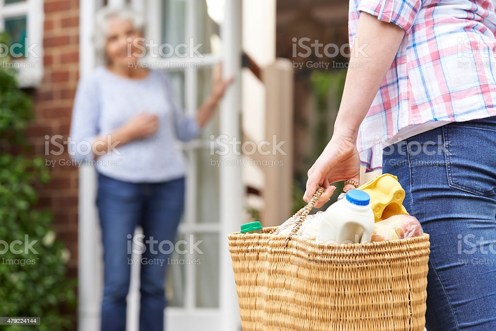 Person Doing Shopping For Elderly Neighbour stock photo
