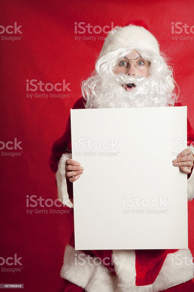 Person Dressed As Santa Holding A Blank Sign royalty-free stock photo
