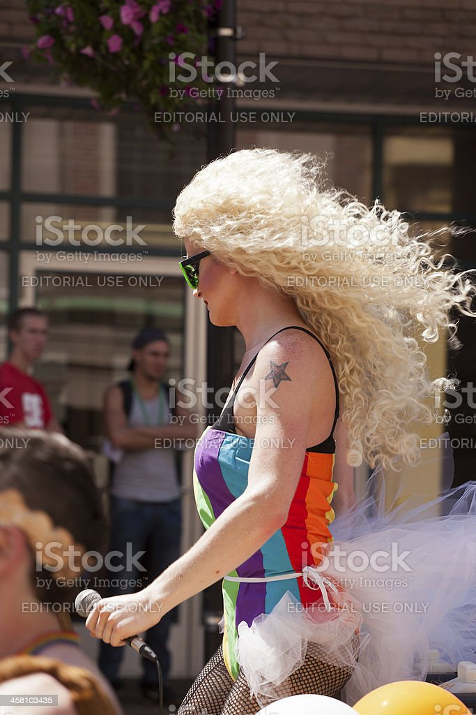 Person Dressed in a Rainbow Outfit During Pride Parade royalty-free stock photo