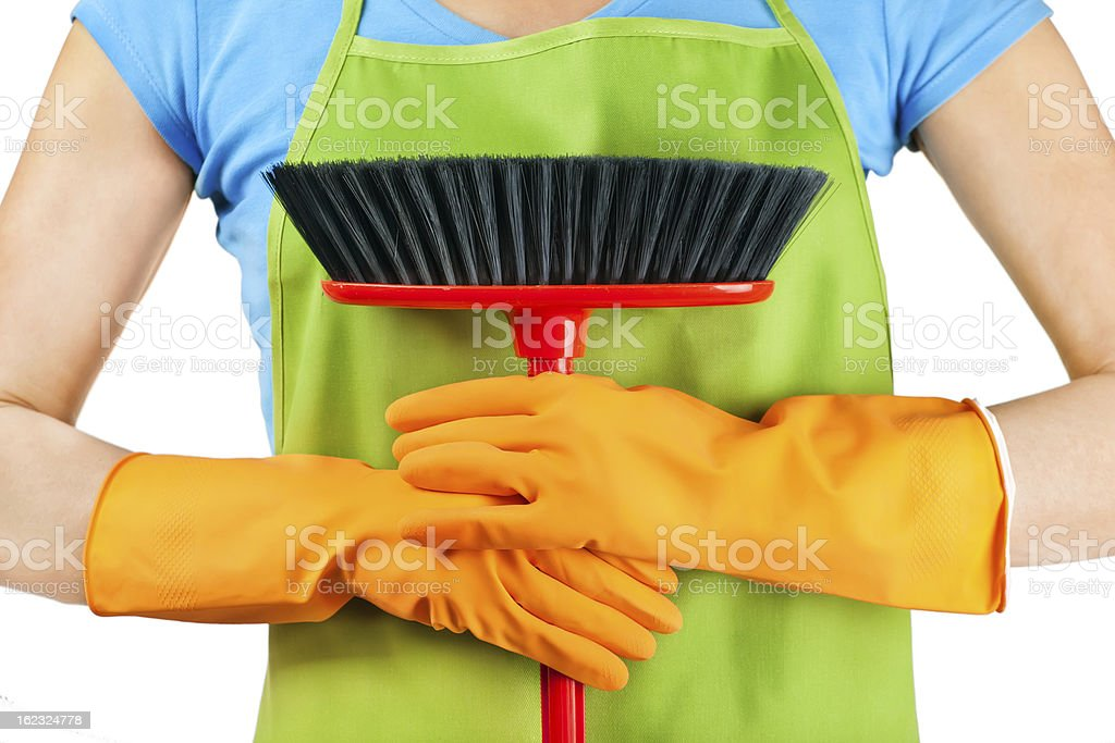 Person dressed in colorful attire preparing to clean royalty-free stock photo