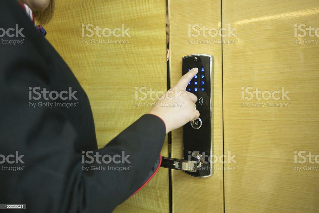 Person entering code at door entry codelock. stock photo