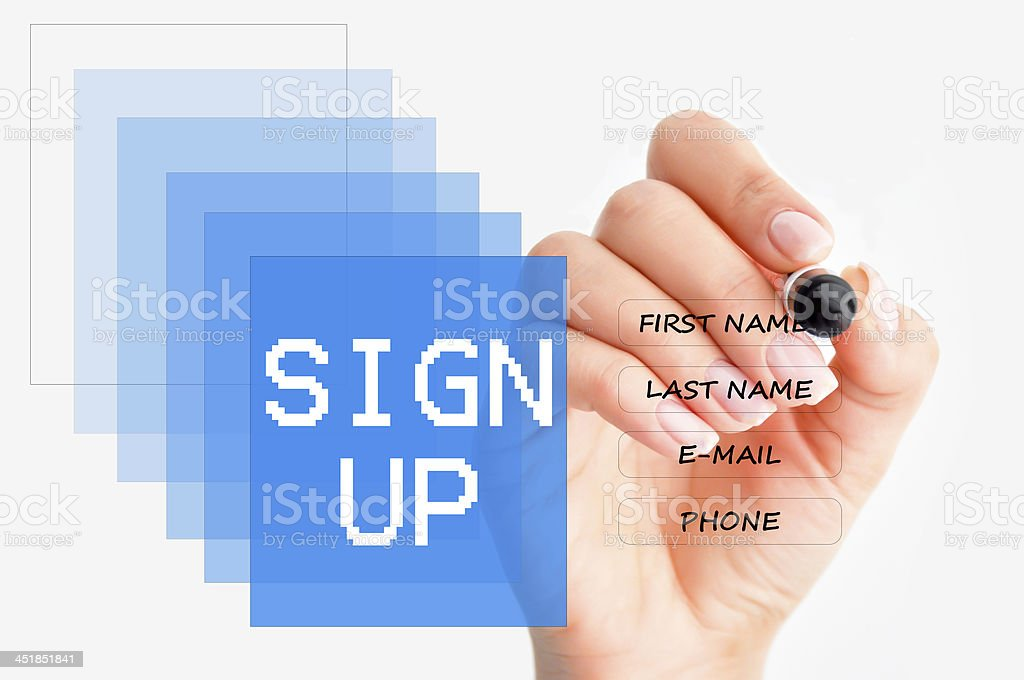 A person filling out a form on the screen stock photo